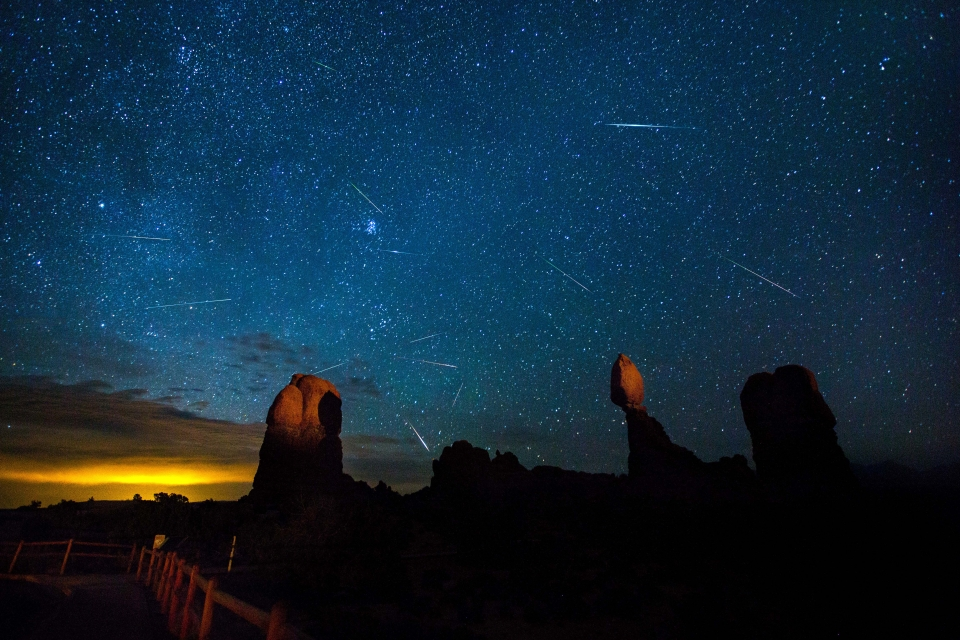 Milky Way rising over Delicate Arch with a Lyrid Meteor