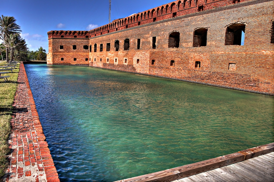 Red brick fort surrounded by green-blue waters at Dry Tortugas National Park