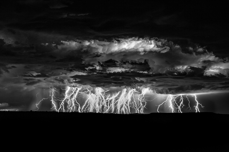 Lightning striking during Thunderstorm Shot in Arches National Park