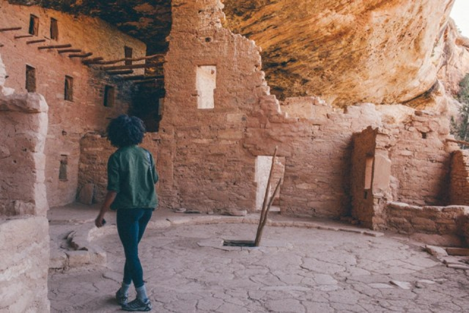 Visitor at ancient Pueblo ruins