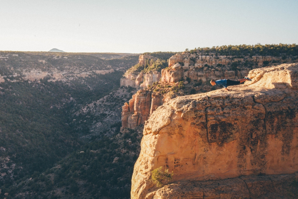 Andia Winslow doing a yoga pose on a cliff at Mesa Verde national park