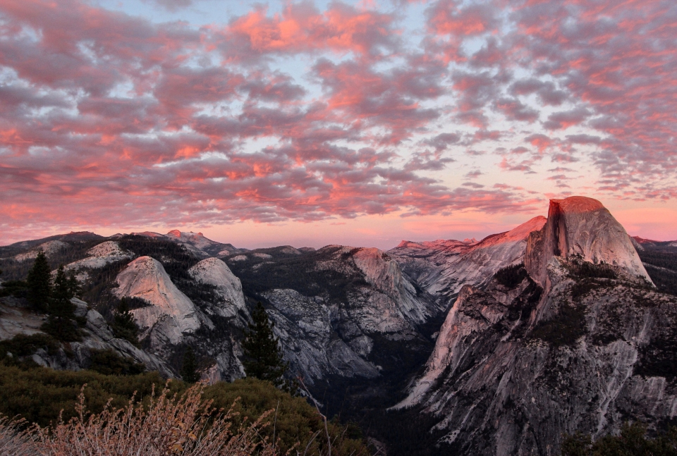 Pink clouds over Half Dome at Yosemite National Park