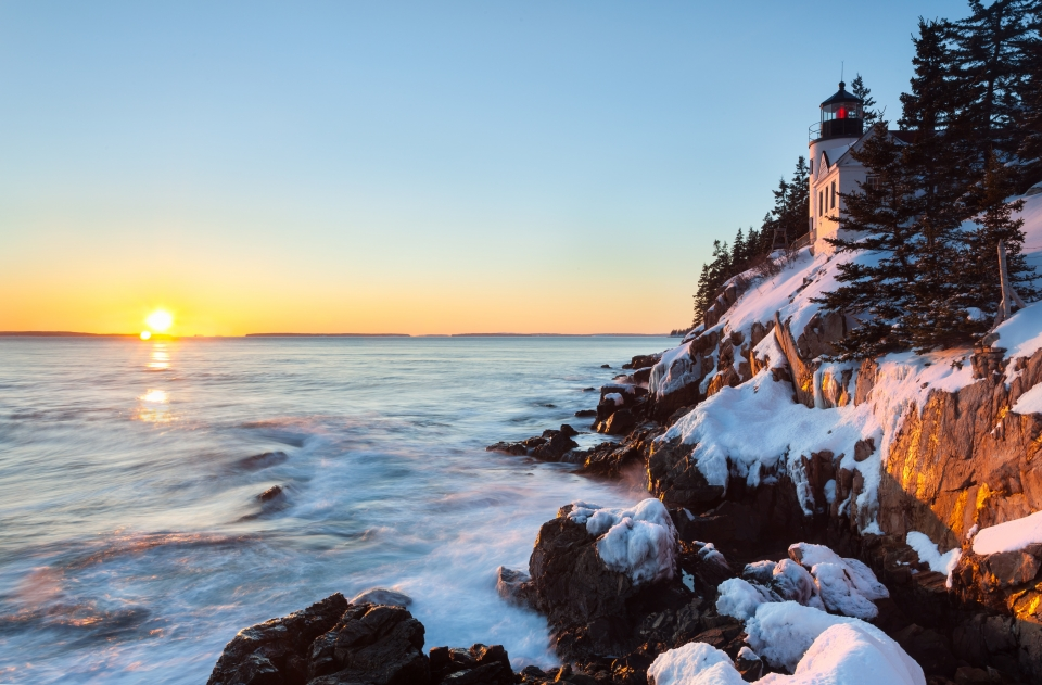 Sunrise on a snow-covered coastline of Acadia National Park