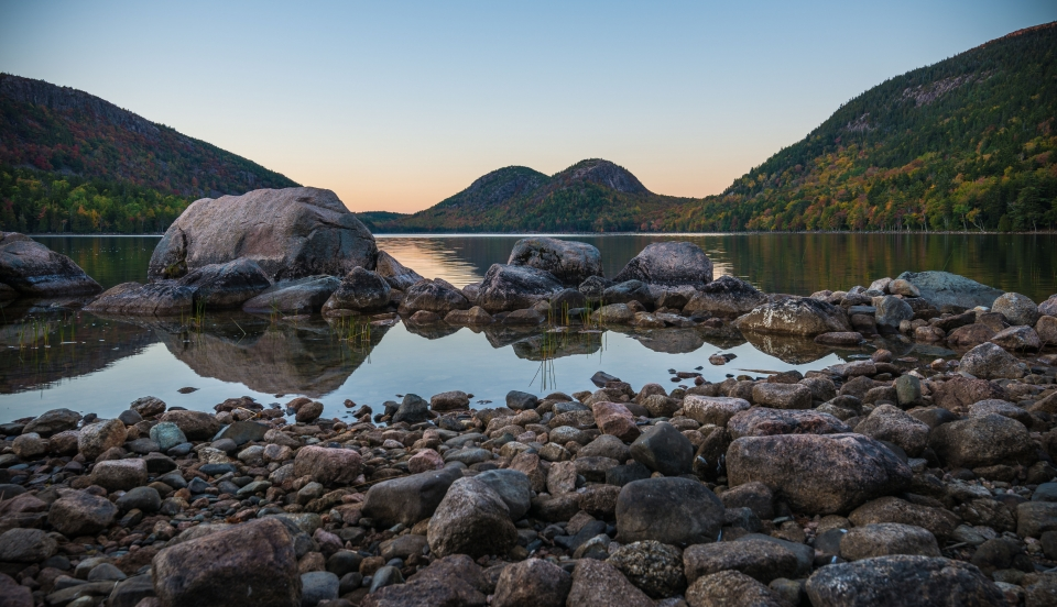 Stones rest upon the shore of Acadia National Park's Jordan Pond.