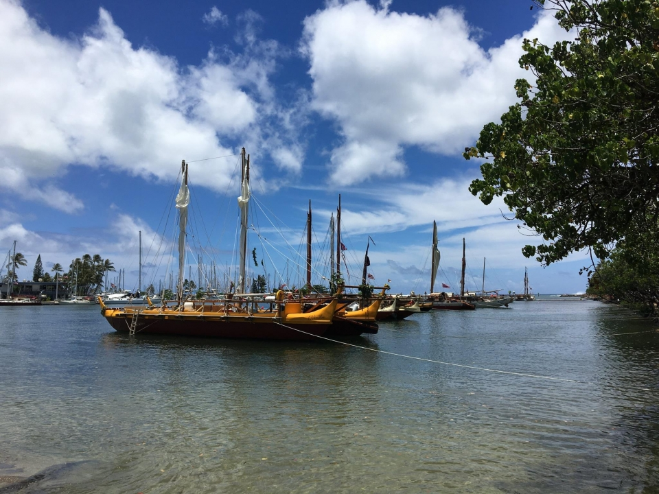 Hawai'ian canoes in the ocean along the Ala Kahakai National Historic Trail