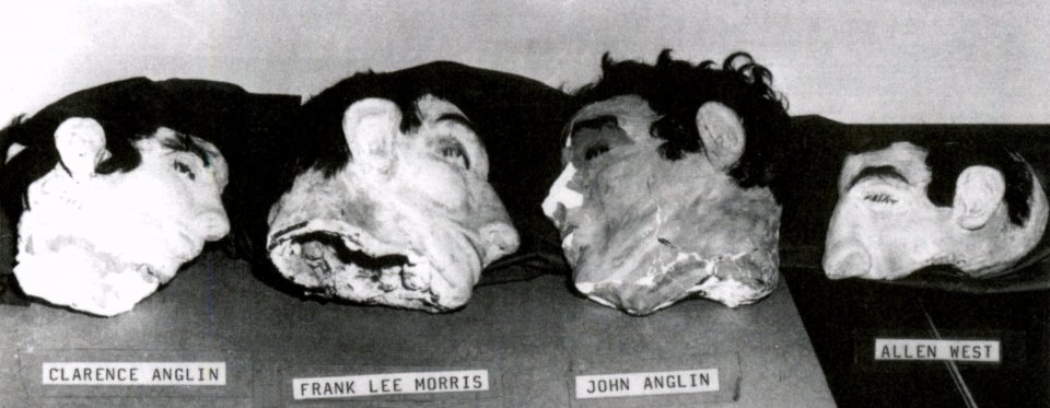 Black and white image of the 4 dummy heads at Alcatraz Island