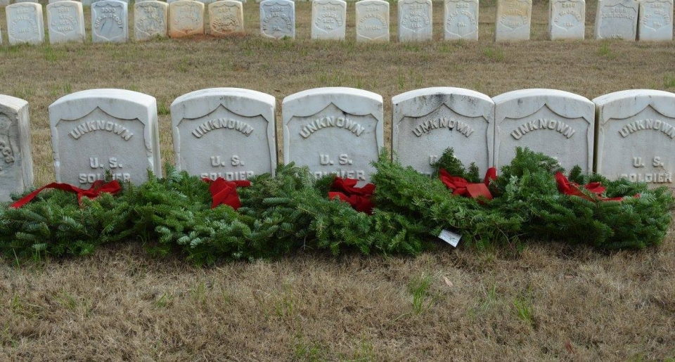 Wreaths on the ground in front tombstones of unkown soldiers at Andersonville National Historic Site