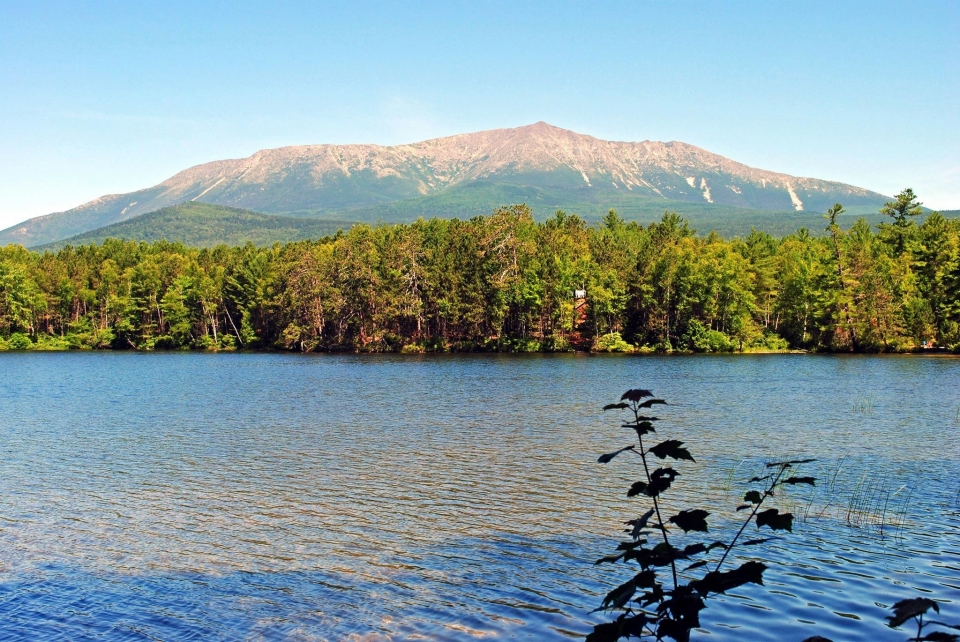 Mount Katahdin across a lake surrounded by trees on the Appalachian National Scenic Trail