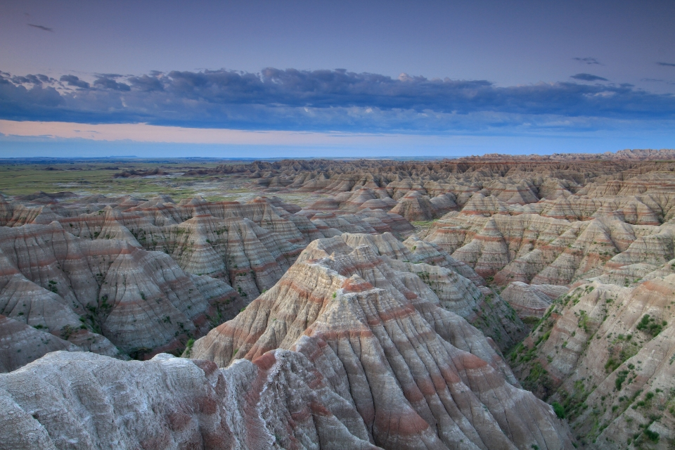 The iconic formations of Badlands National Park reveal their layers resulting from erosion and deposits.