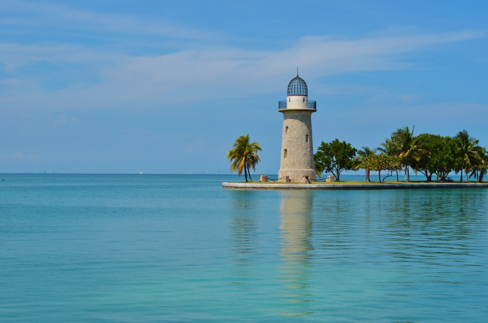 The lighthouse at Biscayne National Park surrounded by bright blue waters