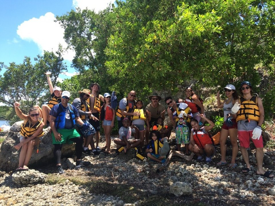 A group of visitors in yellow lifejackets pose for a photo at Biscayne National Park