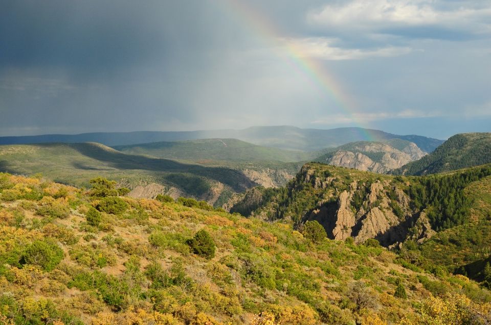 View from the South Rim of Black Canyon of the Gunnison, with a rainbow stretching overhead