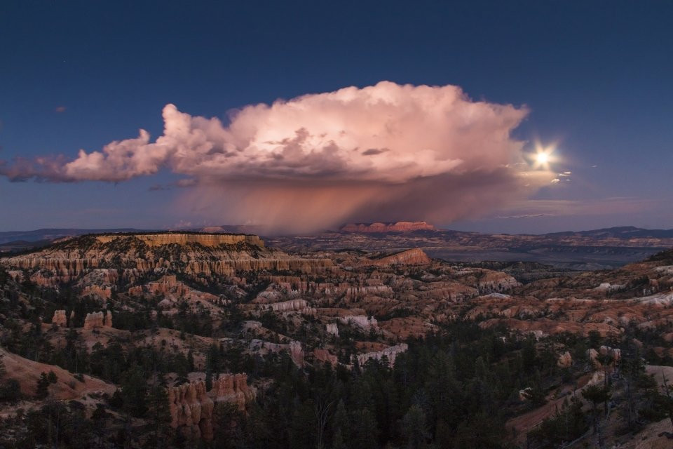 Rainstorm cloud in an otherwise clear sky over Bryce Canyon National Park