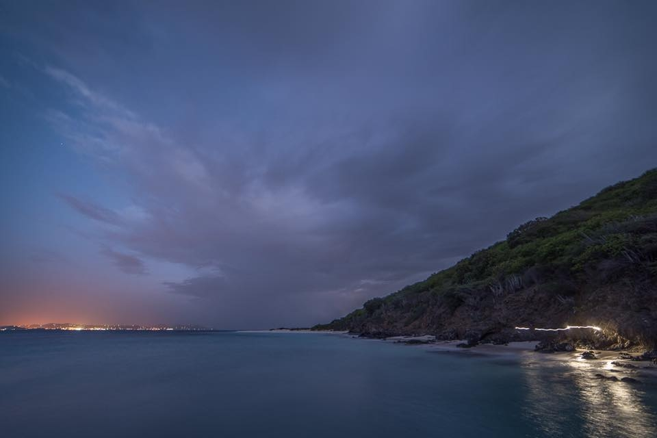 Dark twilight sky over the ocean and beach at Buck Island Reef National Monument