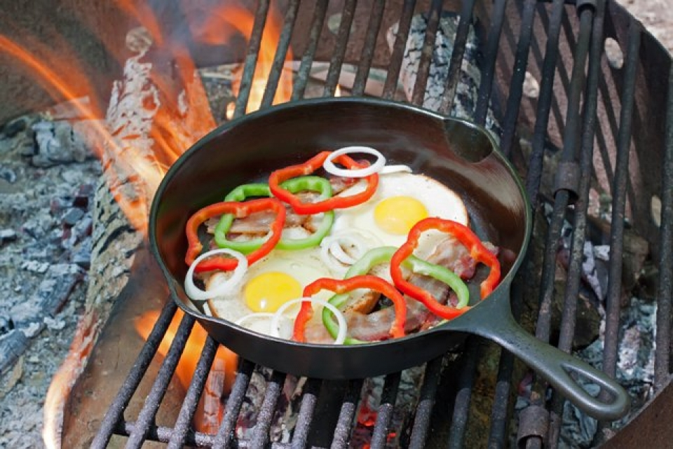 Eggs and bacon on the campfire grill