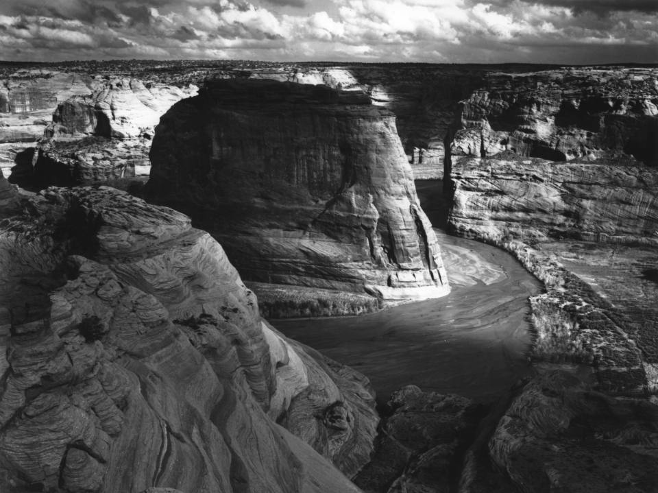 Black and white landscape photograph of Canyon de Chelly National Memorial by Ansel Adams