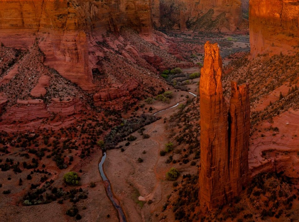 Sunset view of the towering Spider Rock monolith and surrounding landscape at Canyon de Chelly National Monument