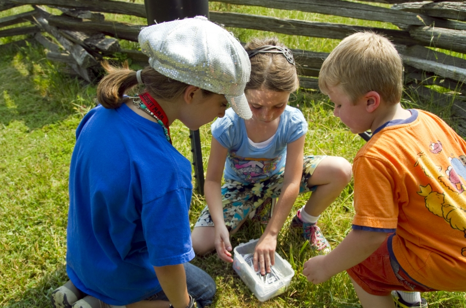 Three children engage in geocaching on the Captain John Smith Chesapeake National Historic Trail