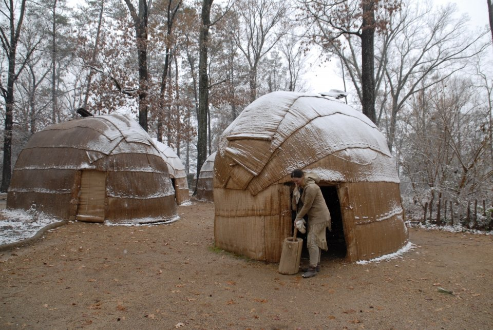 A dusting of snow on the huts of the Powhatan Village at Jamestown along the Captain John Smith Chesapeake Trail