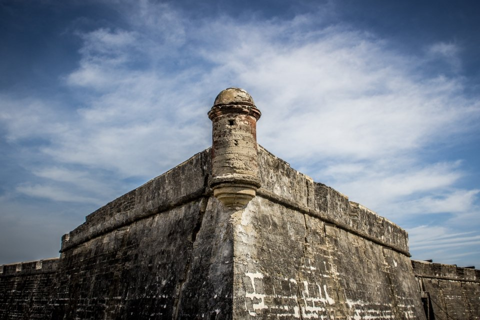 A garita (guard tower) with a cloudy sky in the background