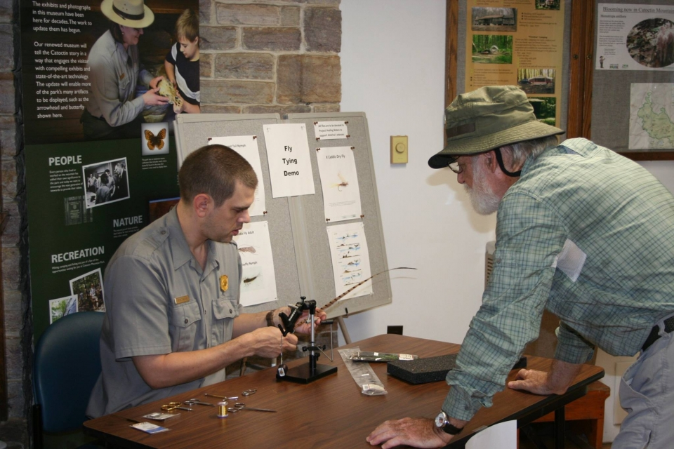 A park ranger demonstration fly fishing at a booth at Catoctin Mountain Park
