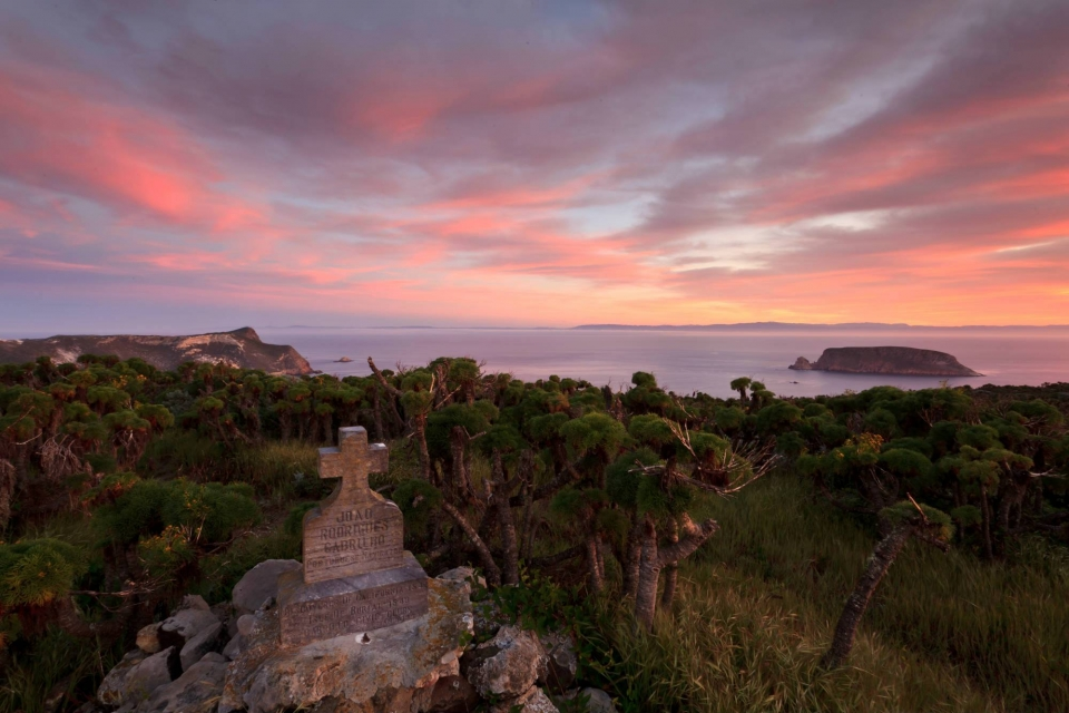 tombstones on San Miguel Island with the pink clouds lit by the setting sun at Channel Islands National Park