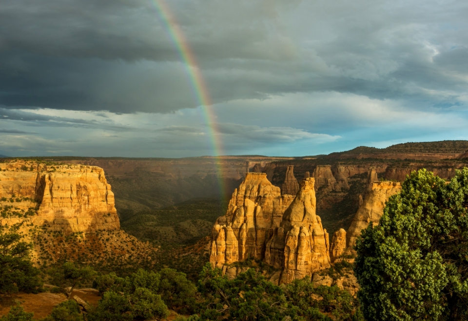 Bottom arc of a rainbow going into the pillars hoodoos of Colorado National Monument