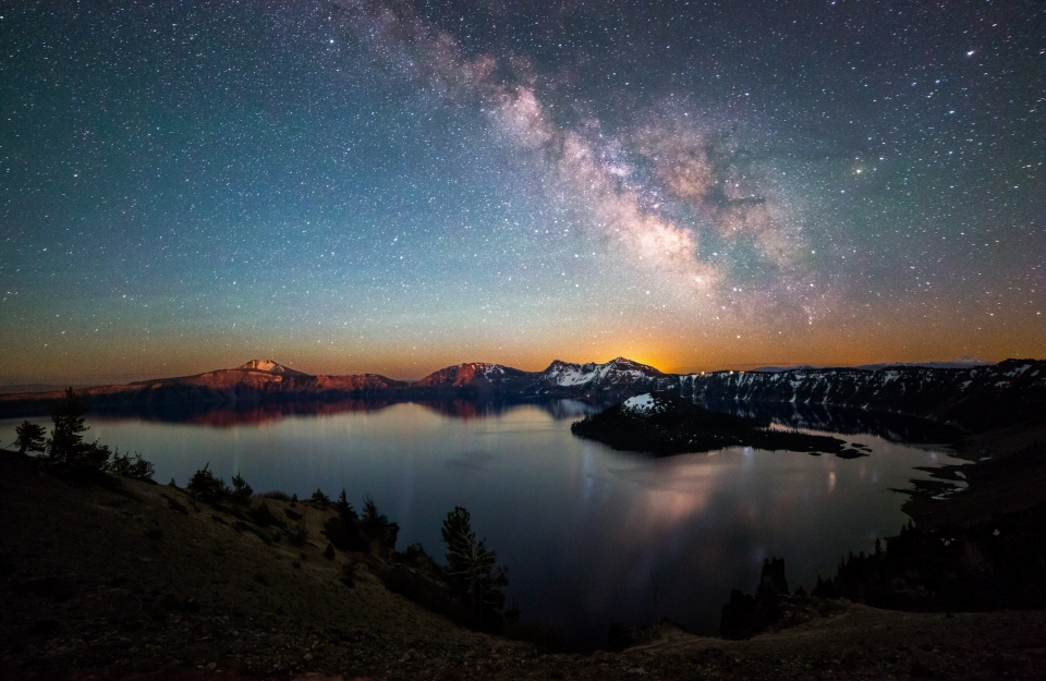 A reflection of the Milky Way's brilliance reflects across Crater Lake.