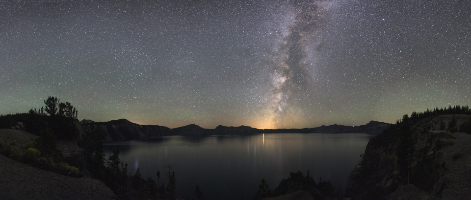 The Milky Way illuminates the night sky over Crater Lake at Crater Lake National Park, Oregon.