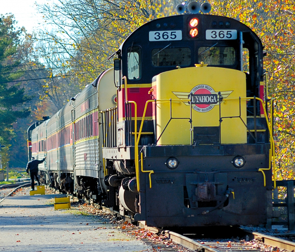 Black Cuyahoga Railway train with red and yellow accents on the tracks