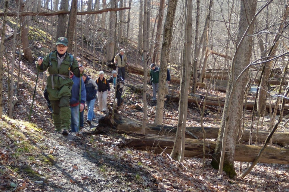 A group of hikers led by a National Park Service ranger through the woods at Cuyahoga Valley National Park