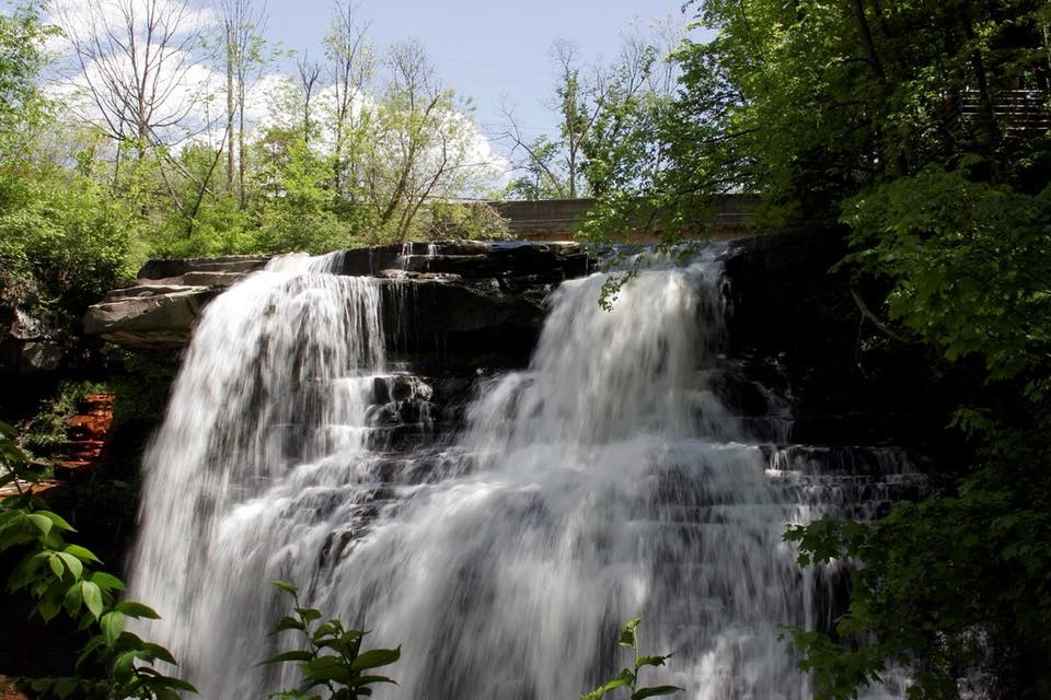 A sun-lit cascading waterfall Brandywine Falls at Cuyahoga Valley National Park