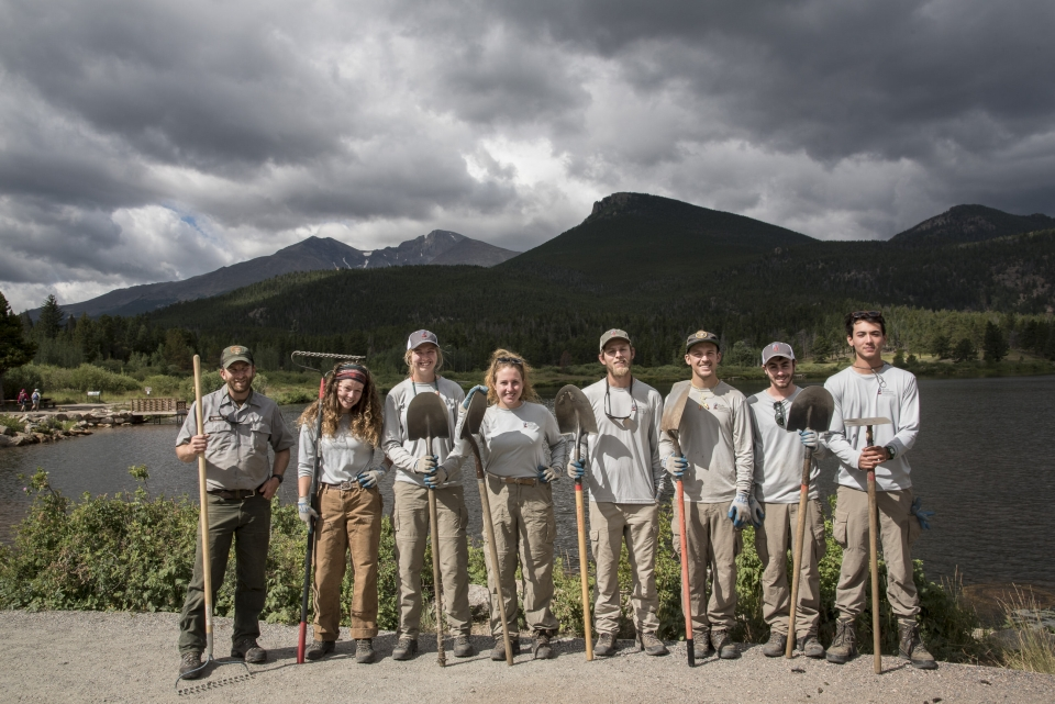 Group of youth standing with shovels in Rocky Mountain National Park