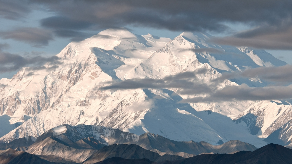A snow-covered Mt. Denali looms in Denali National Park