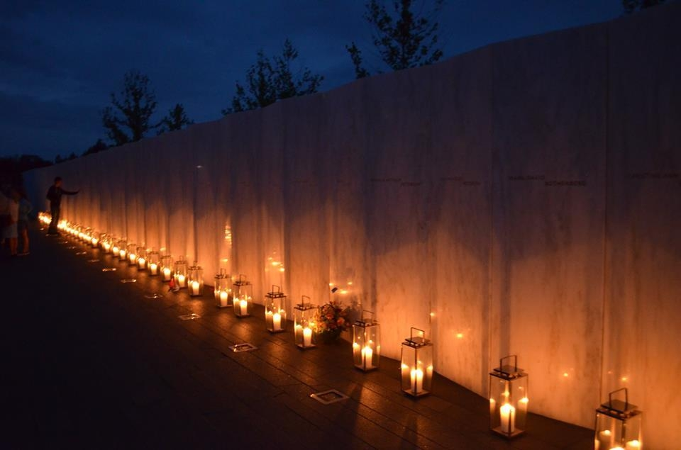 Luminaria, including 40 candle lanterns placed in tribute at the forty panels of the Wall of Names