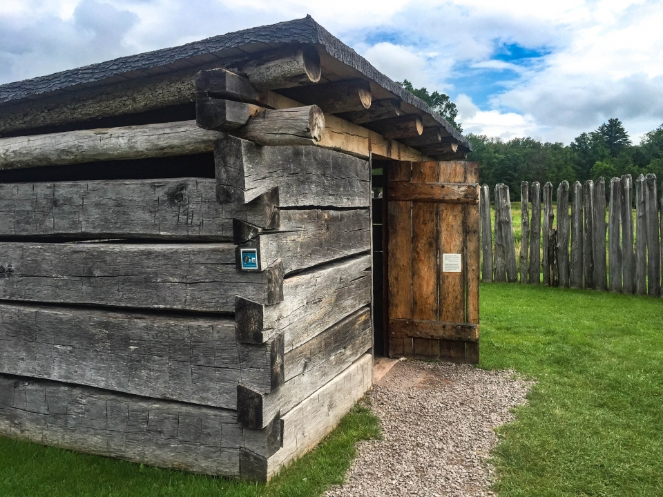Small wooden building inside fort walls at Fort Necessity National Battlefield