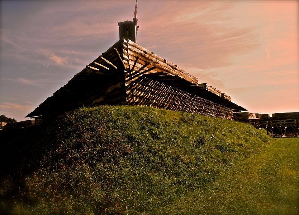 Golden sun shining on the wooden structure at Fort Stanwix National Monument