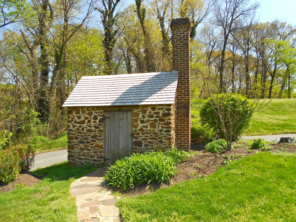 "Frederick Douglass' ""growlery,"" a one-room stone cabin with a brick chimney; Frederick Douglass National Historic Site"