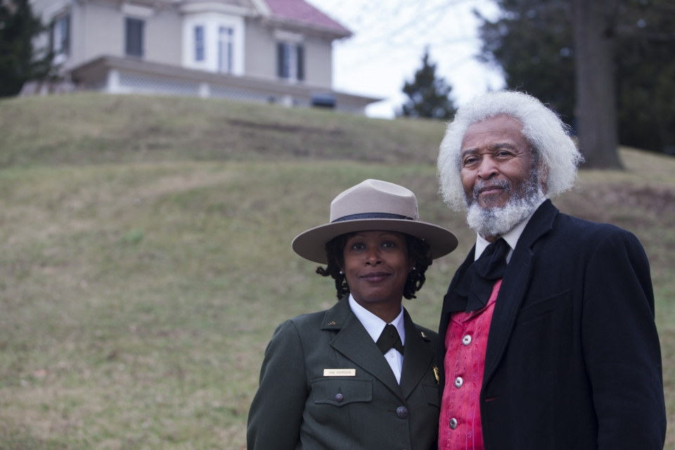 Superintendent Tara Morrison poses with actor Michael Crutcher. Several actors portraying Frederick Douglass were on site over the weekend.