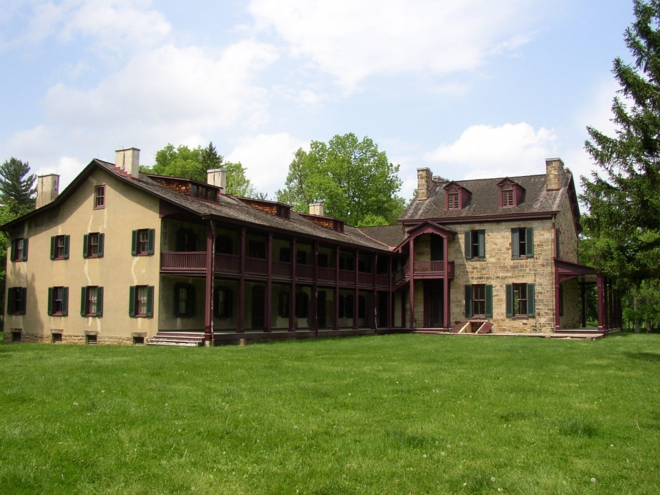 Exterior of the south wing of the yellow and maroon Gallatin House at Friendship Hill National Historic Site