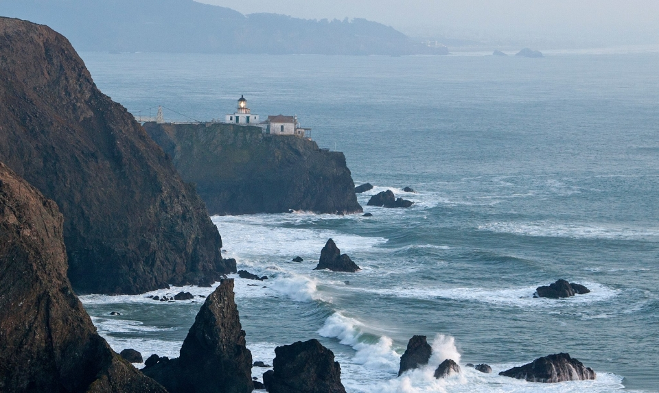 White lighthouse on the rocky coast at Golden Gate National Recreation Area