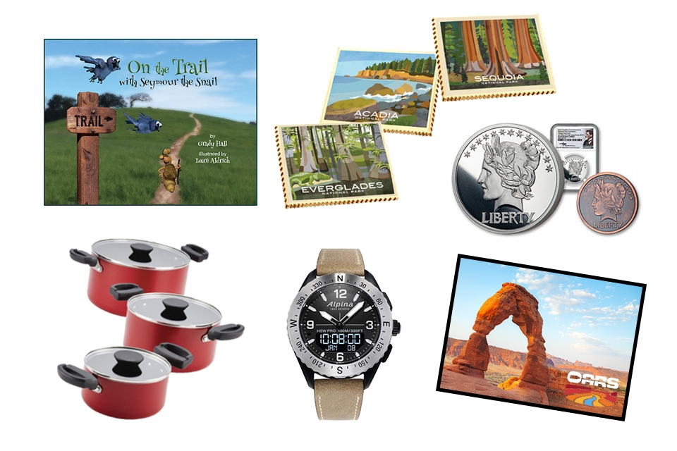 Children's book, stackable pots, collectible national park-themed ingots, a watch, collectible coins and a picture of Arches National Park