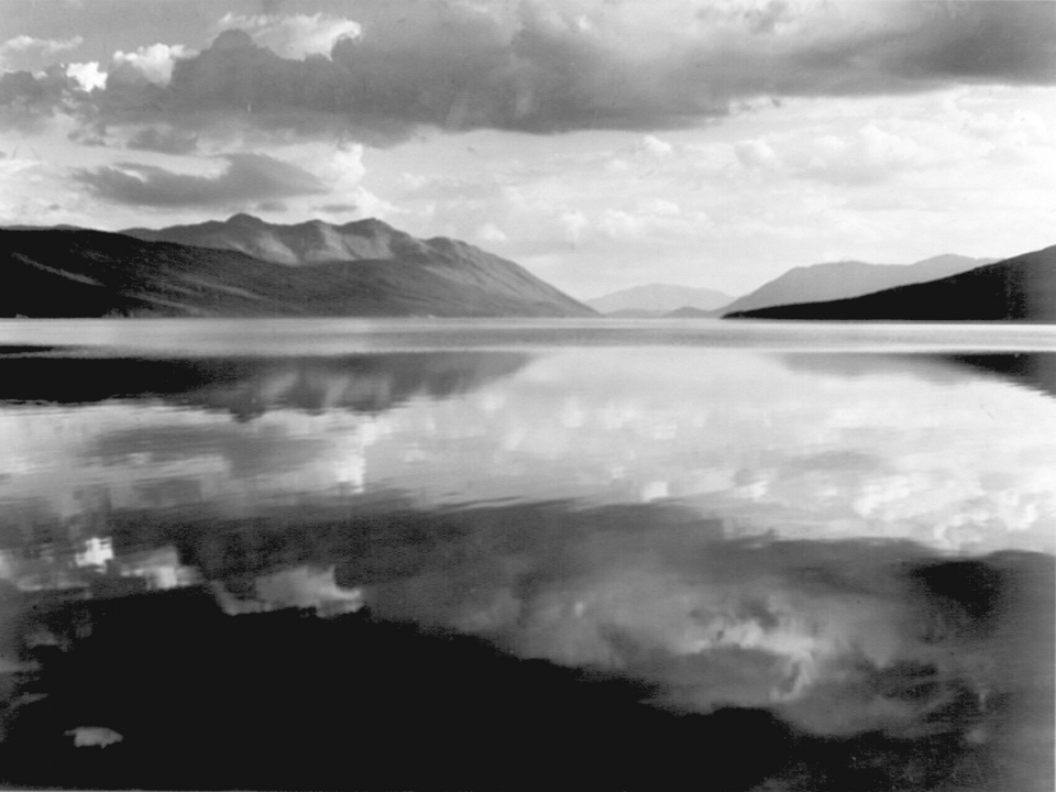 Black and white photograph of McDonald Lake at Glacier National Park by Ansel Adams