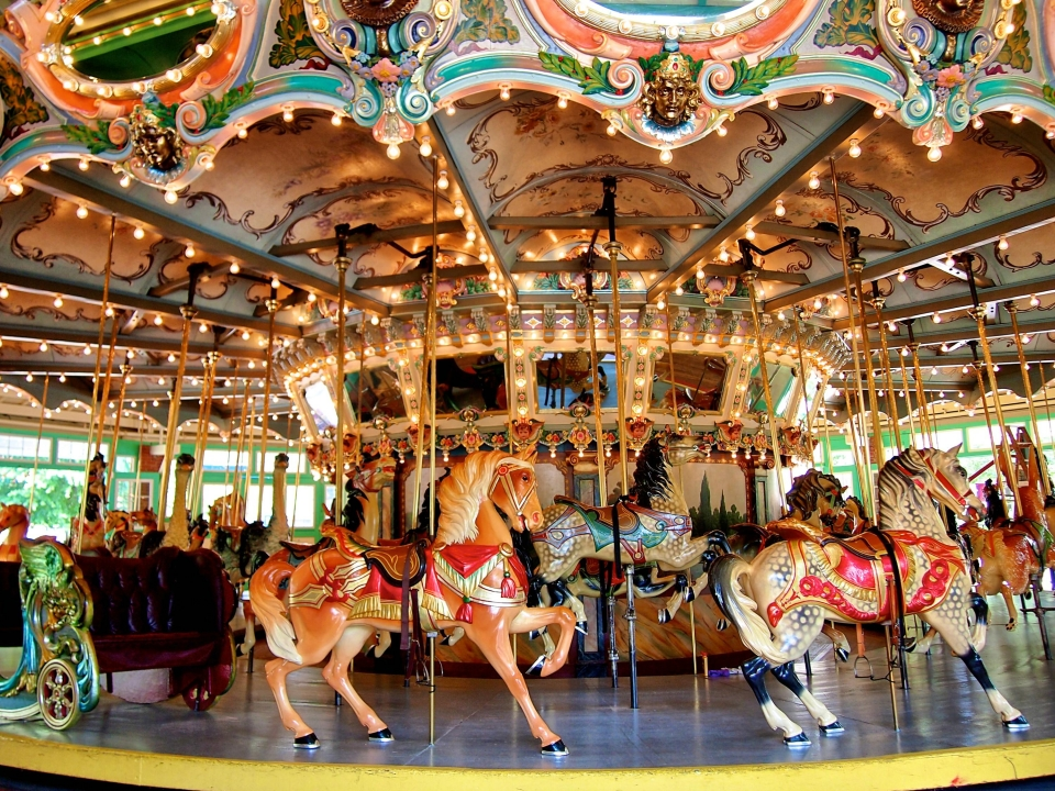A colorful carousel with horses and lights and mirrors at Glen Echo Park
