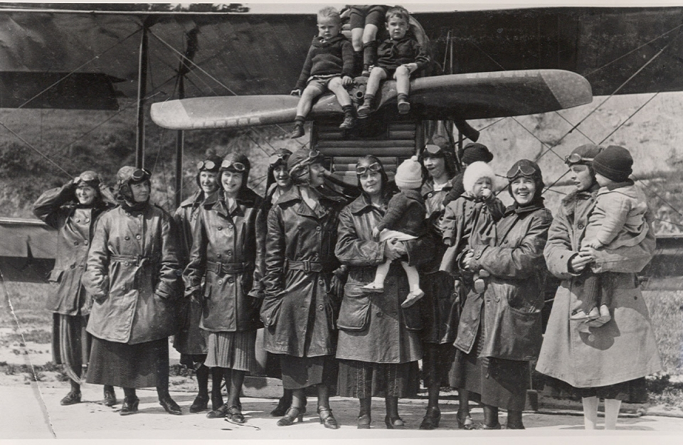 Pilots families standing in front of plane at Golden Gate Recreation Area circa 1920