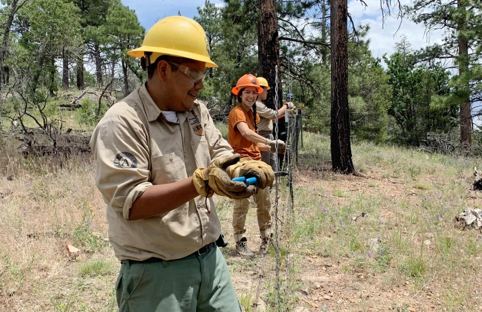 Ty Polacca and other crew 366 members building the park boundary fence at Grand Canyon National Park