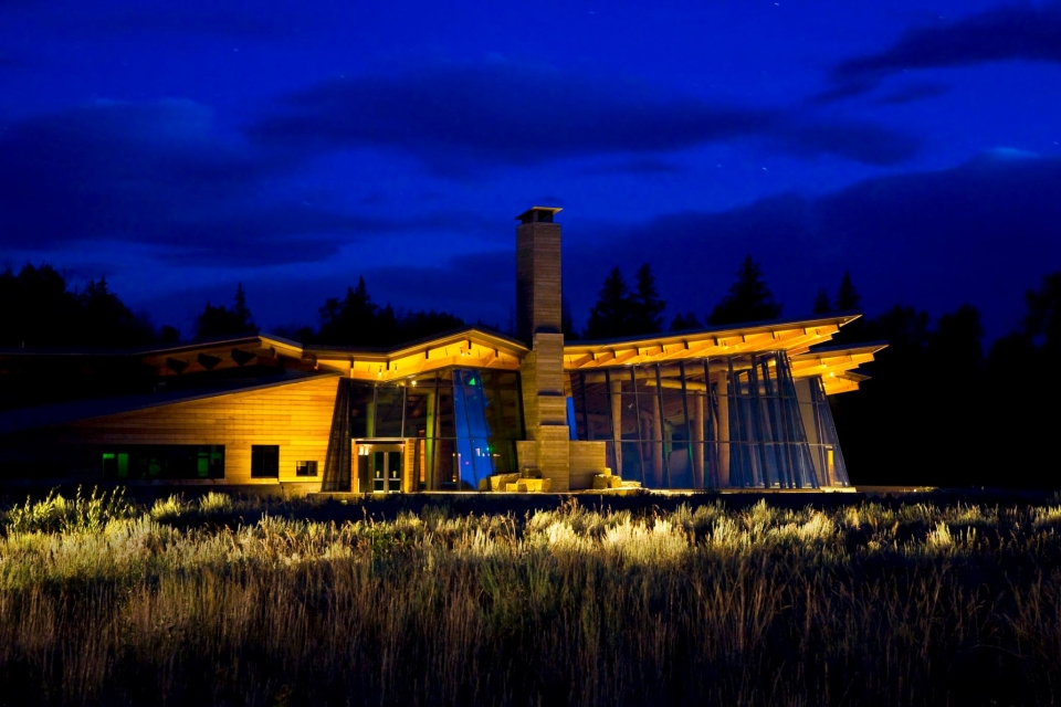 Lit Craig Thomas Discovery and Visitor Center at night at Grand Teton National Park
