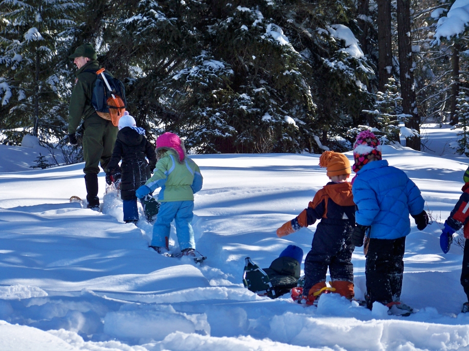 Ranger leads students on a snowshoe hike