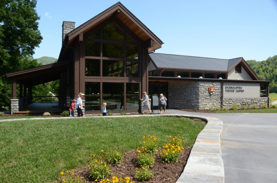 Visitors outside a building - Oconaluftee Visitor Center at Great Smoky Mountains National Park