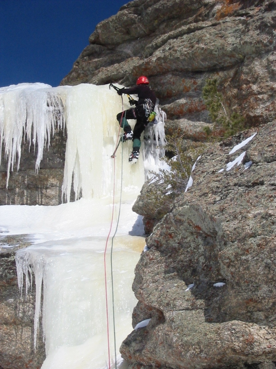 A person leading up ice on double ropes on at City of Rocks National Reserve